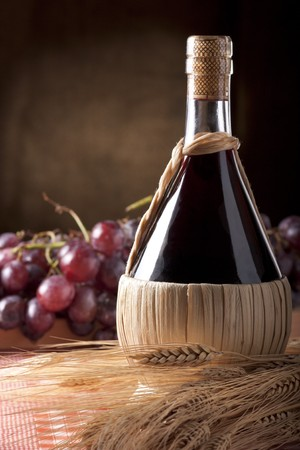 Wine Flask with Wheat and Grapes Stock Photo