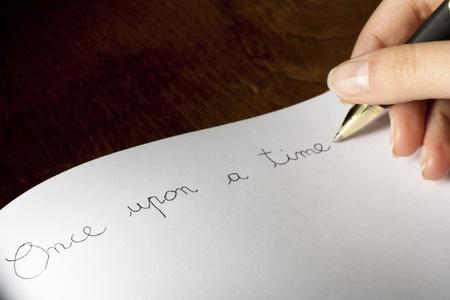 persona escribiendo: �rase una vez Foto de archivo