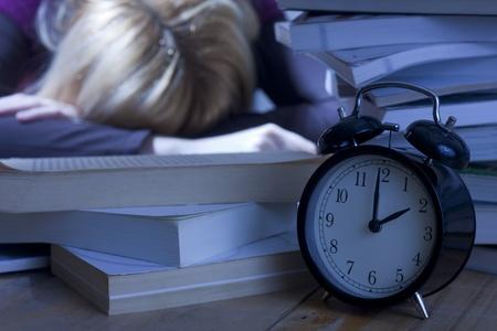 Tired Student Sleeping on Books photo
