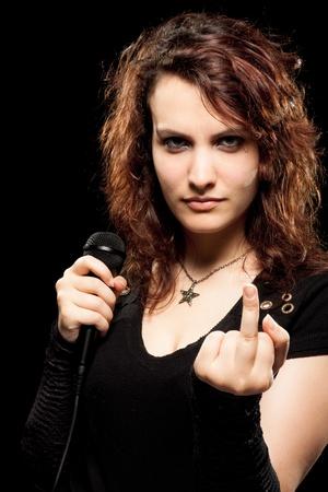 obscene: Woman Rock Singer Showing Middle Finger