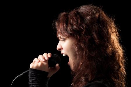 female singer: Woman Rock Singer Screaming Stock Photo