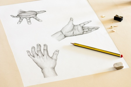 rubber sheet: Drawing Human Hands with Pencil, Eraser and Sharpener Stock Photo