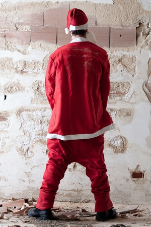 Bad Santa Urinating on a Wall 版權商用圖片