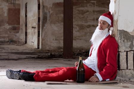 drunk man: Drunken Santa Sleeping on the Floor Stock Photo