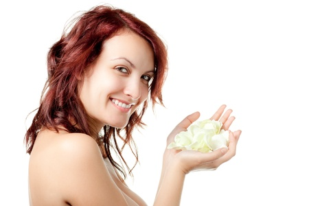 Smiling Naked Woman with Yellow Rose Petals photo