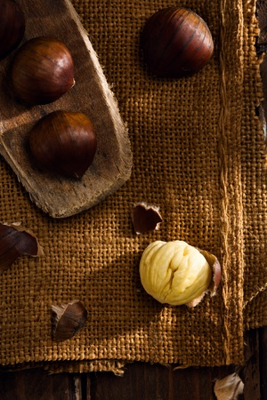Raw Chestnuts on Jute and Wood Stock Photo - 11093334