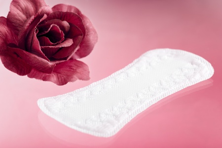 sanitary: Panty Liner with Rose on Pink Background