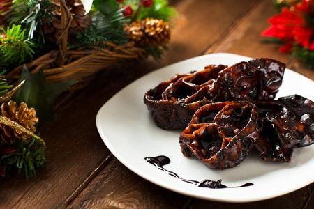 Cartellate met Vincotto, een traditionele kerst Voedsel uit Apulië, Italië Stockfoto