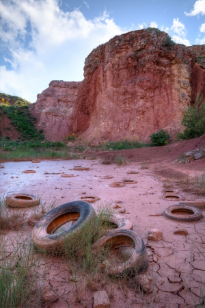 mud pit: Abandoned Tires in a Bauxite Pit Stock Photo