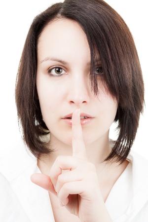 ブルネットの女性は彼女の唇に指を保持しています。 写真素材 - 13664323