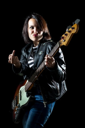 Woman with Electric Bass Guitar Showing Middle Finger photo