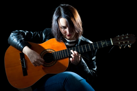 Woman Playing Classical Guitar in a Concert