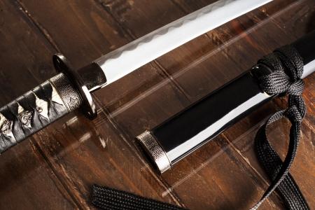 scabbard: Katana Sword with Black Scabbard on Wood