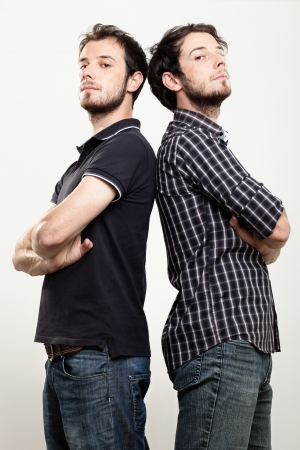 Two Confident Twins with Arms Folded Banco de Imagens