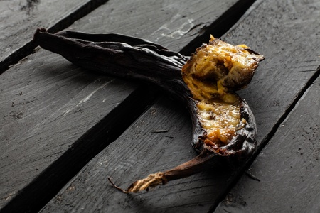 Black Rotten Banana on Wood
