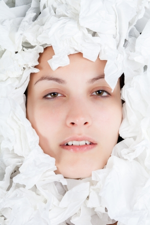 scrunched: Ill Woman Face with Scrunched Paper Tissues