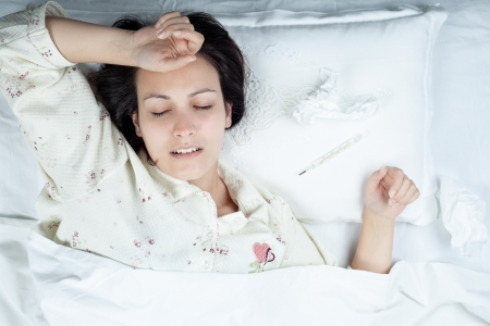 caucasian fever: Ill Woman in Bed with Thermometer and Tissues