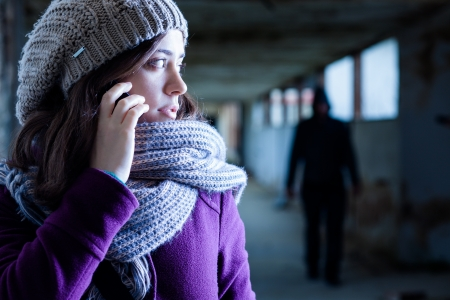 Worried Woman Stalked by a Man Stock Photo - 17154732