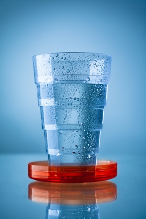 collapsible: Collapsible Plastic Glass Filled with Water Stock Photo