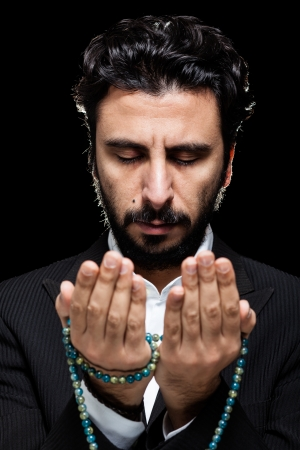 supplication: Western Muslim Praying with Tasbih