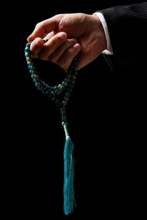 Tasbih、イスラム教徒のロザリオ持っている手 写真素材 - 24325437