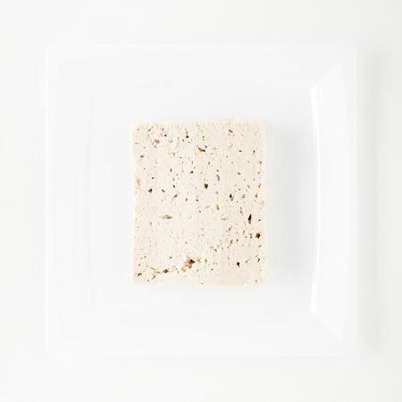 bean curd: Tofu on White Dish on White Background