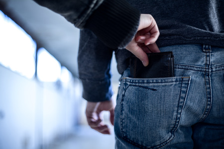 Pickpocket Stealing a Wallet from Pocket on Jeans Foto de archivo