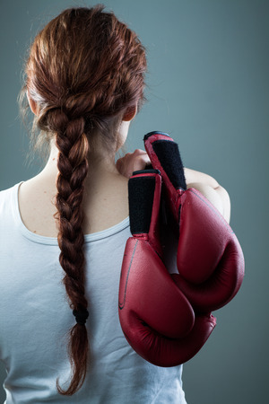 undershirt: Woman with Braid Holding Two Boxing Gloves Stock Photo