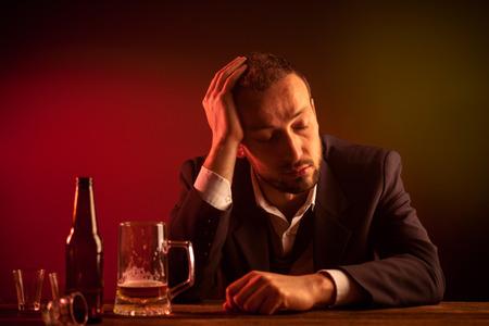 bar: Drunk Sad Businessman Sleeping in a Bar Stock Photo