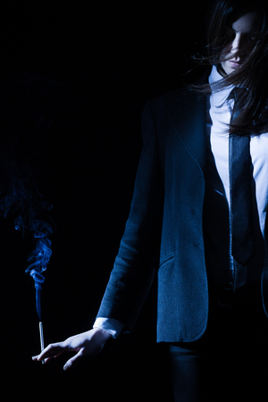 hands on waist: Woman with Tuxedo Holding a Cigarette