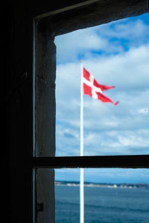 denmark flag: View of a Denmark Flag Through a Wooden Window