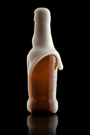 suds: Suds Getting Out of an Overflowing Beer Bottle Stock Photo