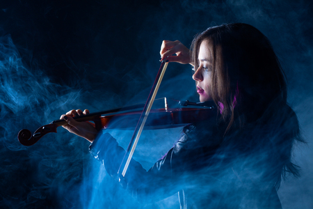 Rock Woman with Leather Jacket Playing a Violin Stock Photo