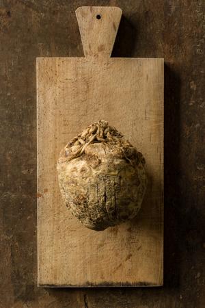 Raw Celeriac on a Wooden Chopping Board