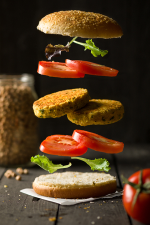 Deconstructured Vegan Hamburger with Chickpea Burger, Lettuce and Tomato 写真素材