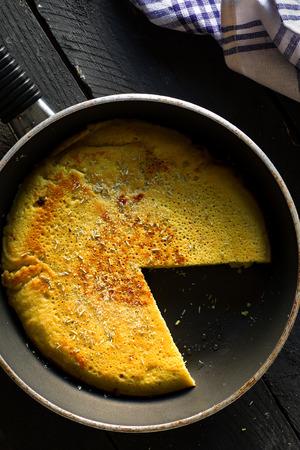Sliced Vegan Chickpea Omelette On a Frying Pan  写真素材
