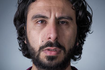 Man with Beard and Long Hair Crying Looking at Camera