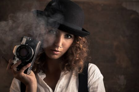 Woman Photographer with Bowler and Suspenders Holding a Cigar