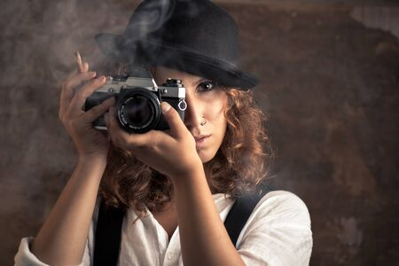 Woman Photographer with Bowler and Suspenders Holding a Cigar 写真素材 - 135402821