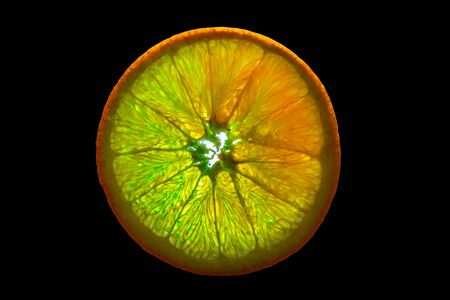 Slice of Orange with Backlight Isolated on Black Background 写真素材 - 135402856