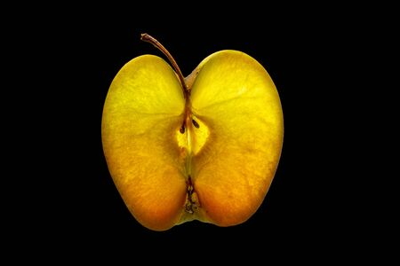 Slice of Apple with Backlight Isolated on Black Background