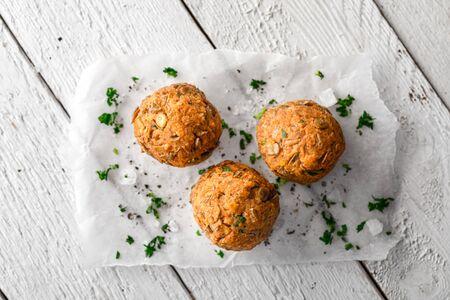 Vegan Lentil Meatballs on Baking Paper on White Wooden Surface