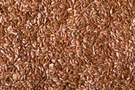 Full Frame Shot of a Bunch of Brown Flaxseeds 写真素材