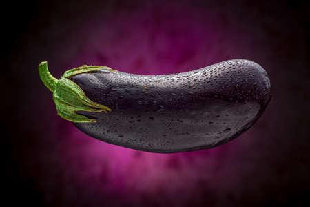 Wet Eggplant Floating with Purple Background