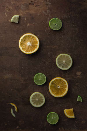 Orange, Lemon and Lime Slices on Grunge Wooden Table 写真素材