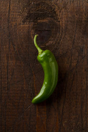 Green Friggitello Chili Pepper with Scattoed Petioles on Wooden Surface