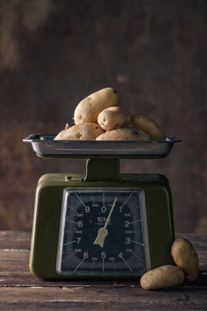 Vintage Scales on Wooden Table with Potatoes