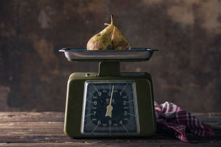 Vintage Scales on Wooden Table with Pears 写真素材