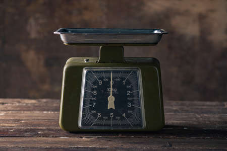 Green Vintage Scales on Wooden Table 写真素材