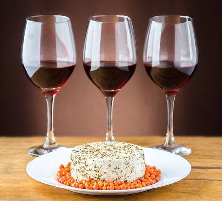 close up at a Panela cheese and wine glasses